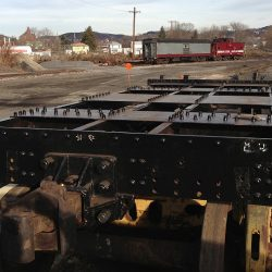 December 2012: A look across the top of the rebuilt frame of #11's tender.  Equipment from the Western Maryland Scenic Railroad rests in the background.