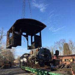 March 2018: A crane lifts Number 39's cab off its frame so that the boiler can be moved into our shops for work.  Alan W. Maples, photograph