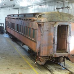 The heavily-weathered exterior of car 1194 is prepped for paint and roof coating at our Duncansville Shop.